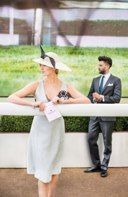 man-and-woman-standing-at-chester-racecourse
