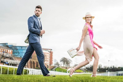 man-and-woman-walking-on-chester-racecourse