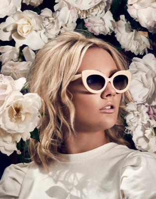 woman-in-sunglasses-in-front-of-white-flowers