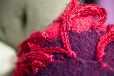 close-up-of-pink-blanket-on-sofa