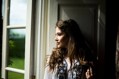 woman-looking-out-of-window