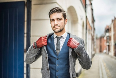 man-in-red-gloves-in-street