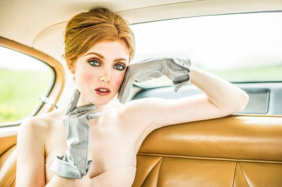 woman-in-satin-gloves-in-vintage-car