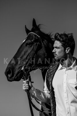 black-and-white-image-man-with-black-horse