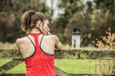 athletic-woman-on-run-with-protein-drink