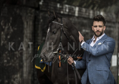 man-in-suit-with-black-horse