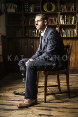 man-in-suit-at-library