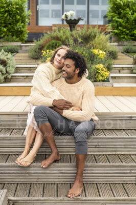 man-and-woman-cuddle-together-outside